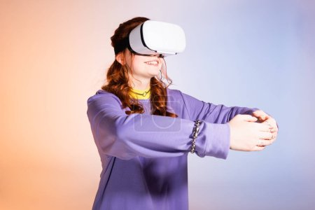 happy female teenager hugging and using virtual reality headset, on purple and beige