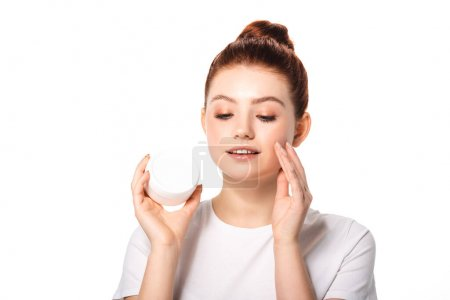 Photo for Beautiful teen girl with perfect skin applying cosmetic cream, isolated on white - Royalty Free Image