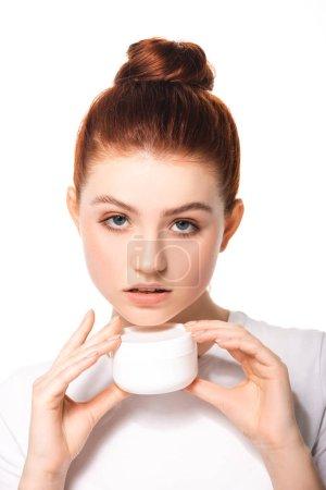 Photo pour Adolescent émotionnel avec peau parfaite contenant du plastique avec crème cosmétique, isolé sur blanc - image libre de droit