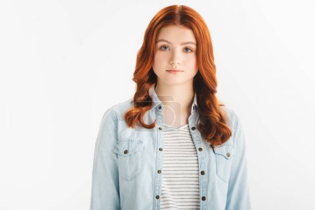 Photo for Beautiful redhead teen girl in denim clothes looking at camera, isolated on white - Royalty Free Image