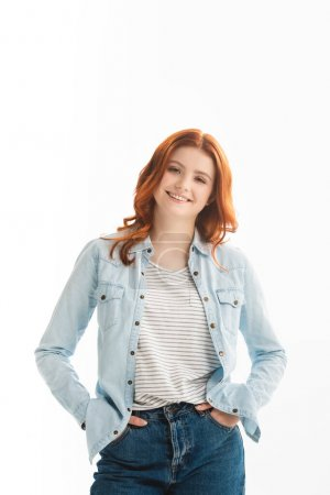 Photo for Cheerful redhead teen girl in denim clothes, isolated on white - Royalty Free Image
