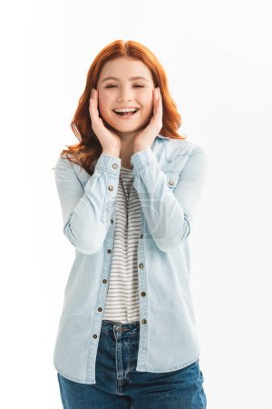 Photo for Excited redhead teen girl in denim clothes, isolated on white - Royalty Free Image