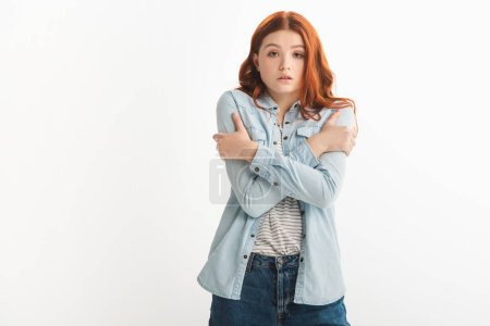 Photo for Sad redhead female teenager cold in denim clothes, isolated on white - Royalty Free Image
