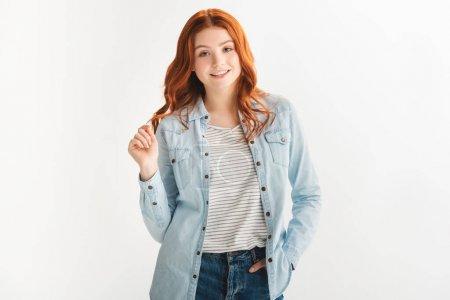 Photo pour Belle rousse adolescente en vêtements en denim, isolée sur blanc - image libre de droit