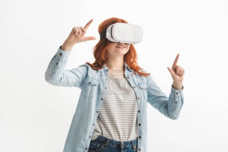 Photo for Beautiful emotional teenager gesturing and using virtual reality headset, isolated on white - Royalty Free Image