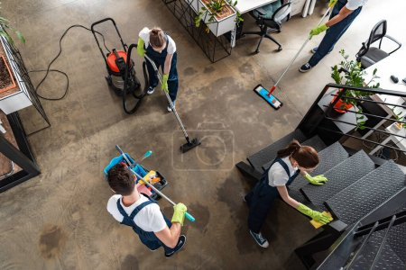Photo for Top view of cleaning company team cleaning modern office - Royalty Free Image