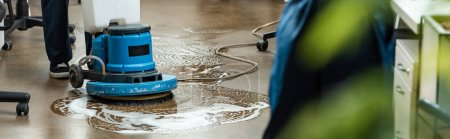 Photo for Cropped view of cleaner washing floor with cleaning machine, panoramic shot - Royalty Free Image