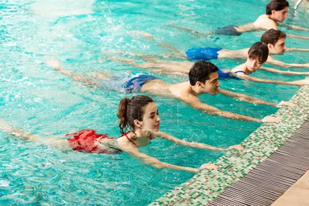 Photo for Group of young people training together in swimming pool - Royalty Free Image