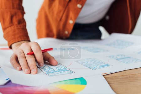Photo for Selective focus of developer planning app sketches for user experience design on table isolated on grey - Royalty Free Image