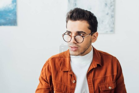 Photo for Handsome man in eyeglasses looking away at home - Royalty Free Image