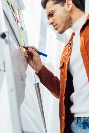 Photo for Low angle view of ux developer planning app interface on whiteboard in office - Royalty Free Image