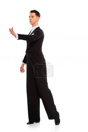 elegant young ballroom dancer dancing isolated on white