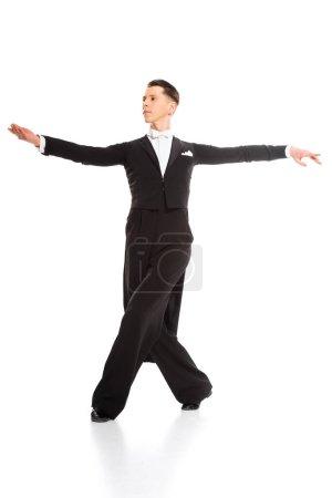 élégante jeune danseuse de salon dansant isolée sur blanc