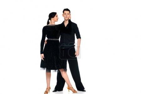 Foto de Elegante y joven pareja de bailarines de salón de baile con vestido negro y baile de traje aislado en blanco. - Imagen libre de derechos