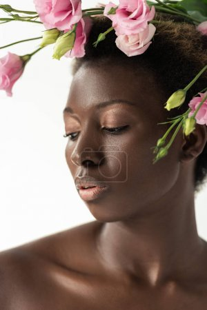 Photo for Tender nude african american woman with pink eustoma flowers isolated on white - Royalty Free Image