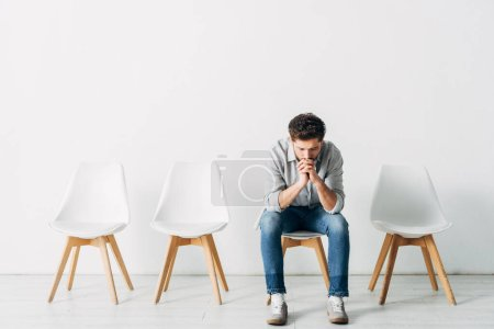 Photo for Pensive employee waiting for job interview in office - Royalty Free Image