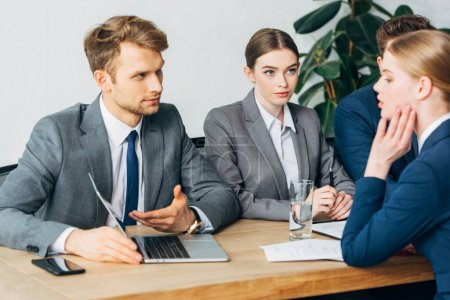 Photo for Selective focus of recruiters looking at employee during job interview - Royalty Free Image