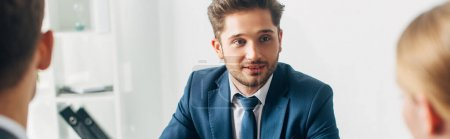 Photo for Selective focus of employee looking at recruiter in office, panoramic shot - Royalty Free Image