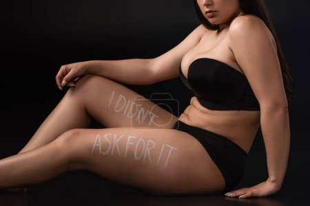 Photo for Cropped view of plus size model with lettering I Did not Ask For It on body on black background - Royalty Free Image