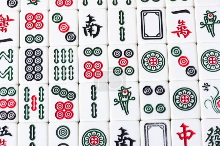KYIV, UKRAINE - JANUARY 30, 2019: top view of field of mahjong game tiles with signs and characters