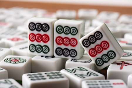 KYIV, UKRAINE - JANUARY 30, 2019: selective focus of white mahjong game tiles with dots ornate