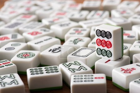 KYIV, UKRAINE - JANUARY 30, 2019: selective focus of white mahjong game tiles with signs and characters
