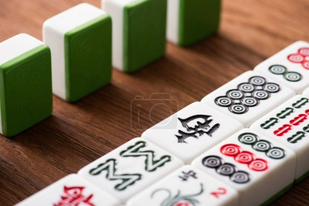 KYIV, UKRAINE - JANUARY 30, 2019: selective focus of mahjong game tiles rows on wooden table