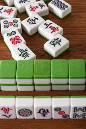 Photo for KYIV, UKRAINE - JANUARY 30, 2019: selective focus of mahjong game tiles with signs and symbols on wooden surface - Royalty Free Image