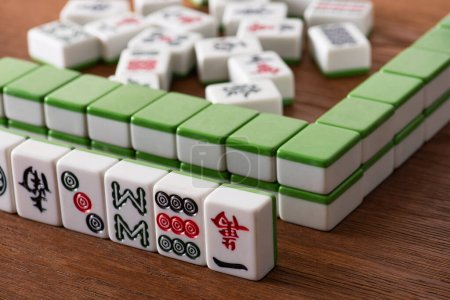 Photo for KYIV, UKRAINE - JANUARY 30, 2019: selective focus of mahjong game tiles rows on wooden surface - Royalty Free Image