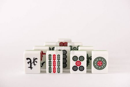 KYIV, UKRAINE - JANUARY 30, 2019: mahjong game tiles with signs and characters on white background with copy space