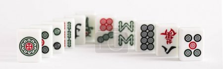 Photo for KYIV, UKRAINE - JANUARY 30, 2019: selective focus of mahjong game tiles with signs and characters on white background, panoramic shot - Royalty Free Image