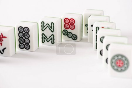 Photo for KYIV, UKRAINE - JANUARY 30, 2019: selective focus of mahjong game tiles with signs and characters on white background - Royalty Free Image