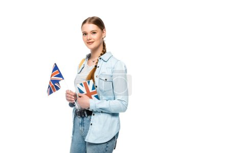 pretty student with backpack holding book and British flag isolated on white