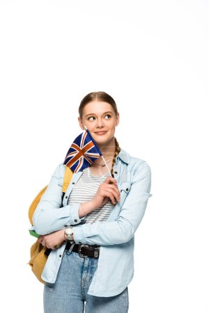 dreamy pretty student with backpack holding book and British flag isolated on white