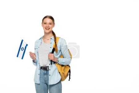 smiling pretty student with backpack holding flag of Israel isolated on white