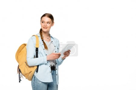 smiling pretty student with backpack holding digital tablet isolated on white