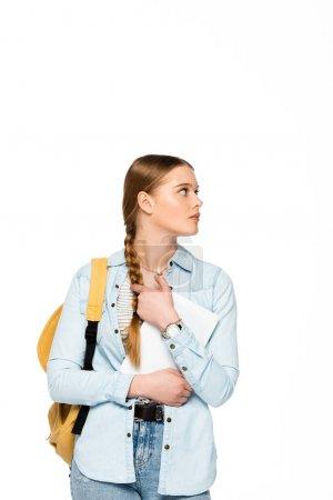 Photo pour Jolie étudiante avec sac à dos tenant tablette numérique et regardant loin isolé sur blanc - image libre de droit