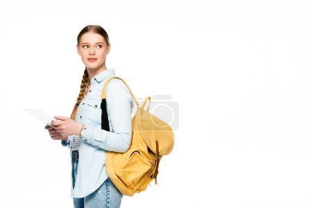 pretty student with backpack using digital tablet and looking away isolated on white
