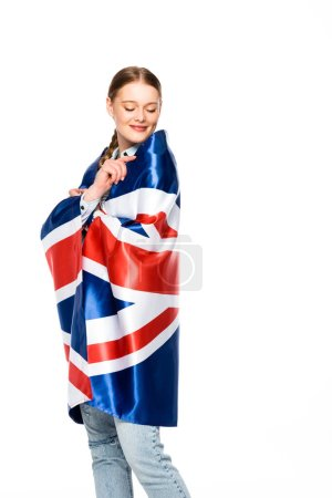 Photo for Happy pretty girl with braid wrapped in uk flag isolated on white - Royalty Free Image