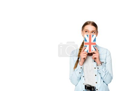 Photo for Pretty girl with obscure face holding book with uk flag isolated on white - Royalty Free Image