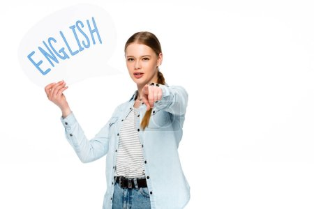 girl with braid holding speech bubble with English lettering and pointing at camera isolated on white