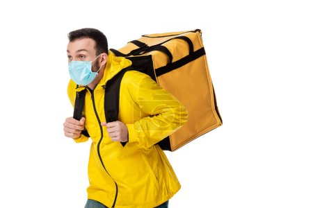 Photo for Delivery man in medical mask and backpack with order isolated on white - Royalty Free Image