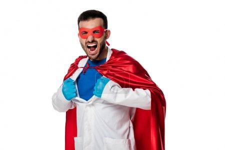 Photo pour Docteur émotionnel en costume de super-héros enlever manteau blanc isolé sur blanc - image libre de droit