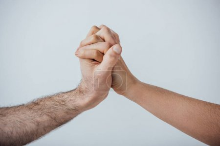 Photo for Cropped view of men holding hands isolated on grey - Royalty Free Image
