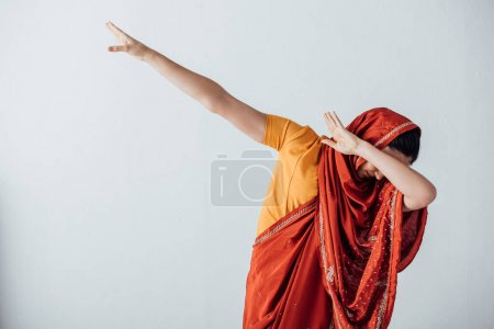 Photo for Woman in sari covering face isolated on grey - Royalty Free Image
