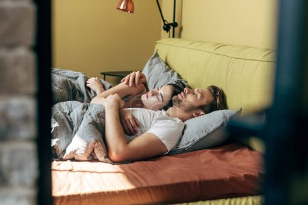 Photo for Selective focus of handsome man and attractive woman sleeping in bed - Royalty Free Image