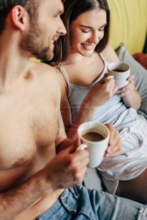 Photo for Selective focus of cheerful couple holding cups with coffee - Royalty Free Image