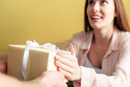 Photo for Selective focus of man giving present to happy girlfriend - Royalty Free Image