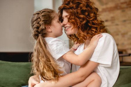Photo for Cute daughter hugging and touching noses with happy  mother - Royalty Free Image