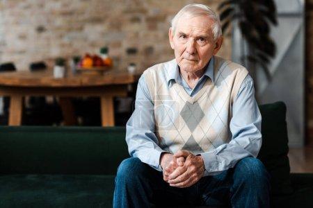 Photo for Sad lonely senior man sitting on sofa during self isolation - Royalty Free Image